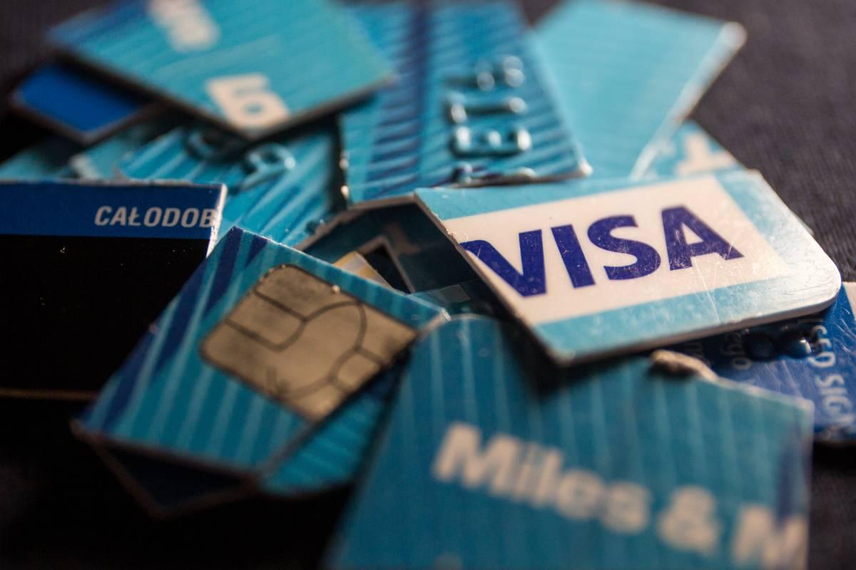 A Visa credit card is cut up.