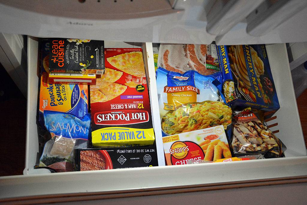 Various Frozen packaged food seen in a freezer drawer
