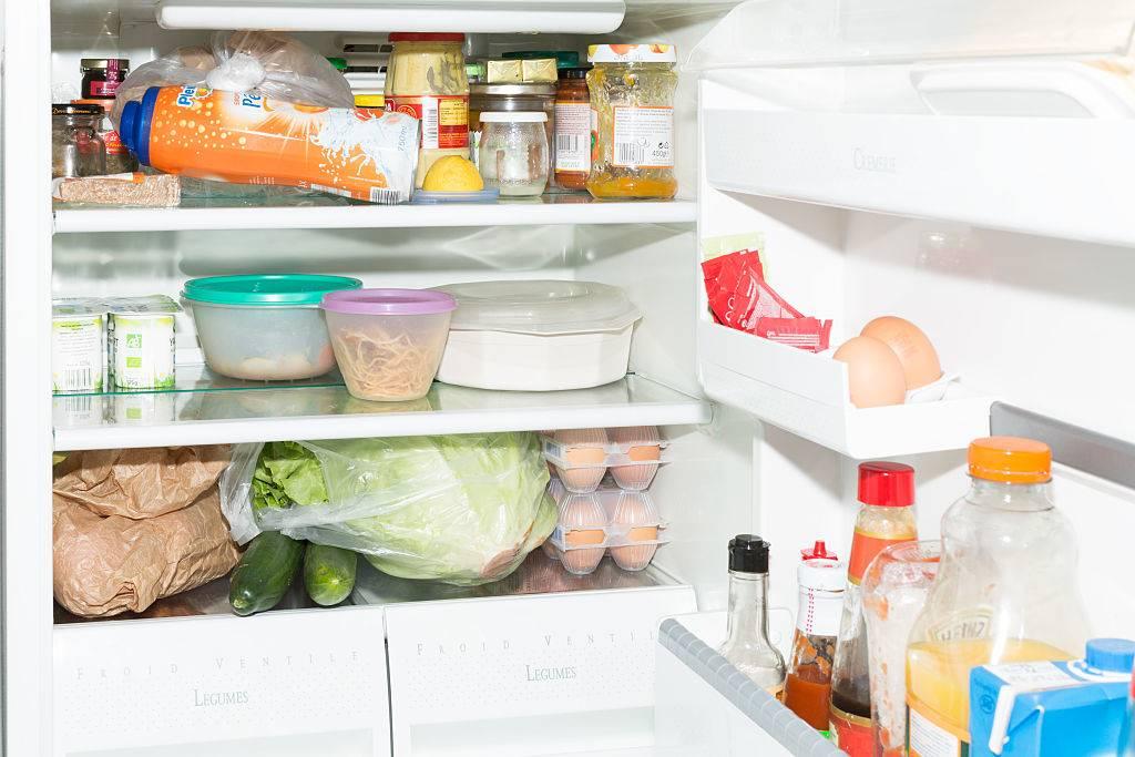 Inside fridge with the door full of food