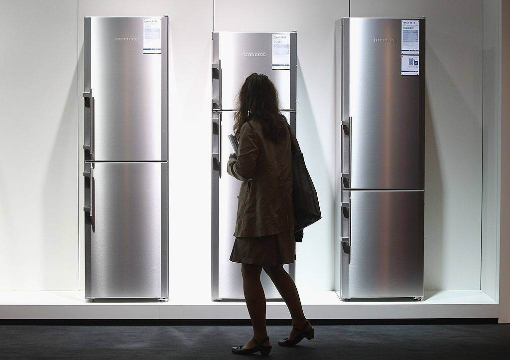 A woman looks at the latest generation of refrigerators