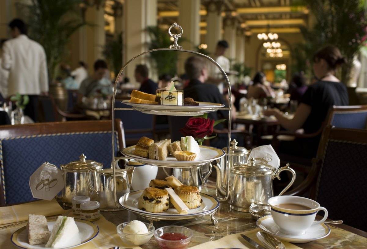 A high tea three-tier tray holds food at the Peninsula Hotel.