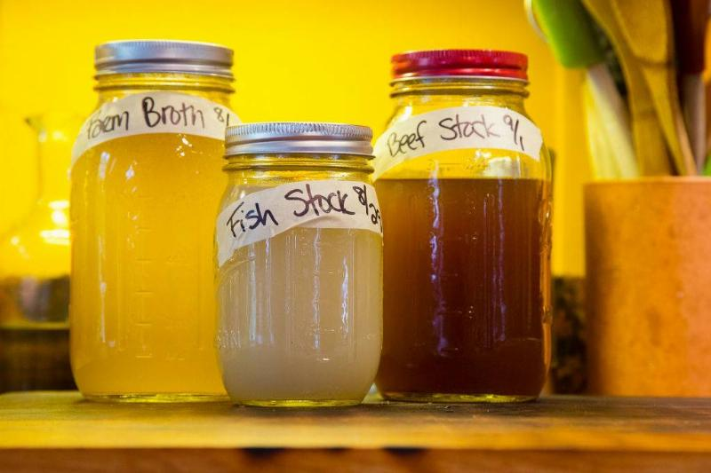 mason jars with stocks inside with labels on the front