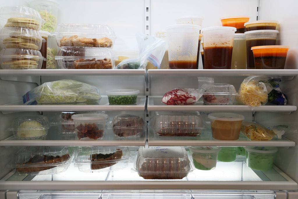 food in clear containers inside a fridge