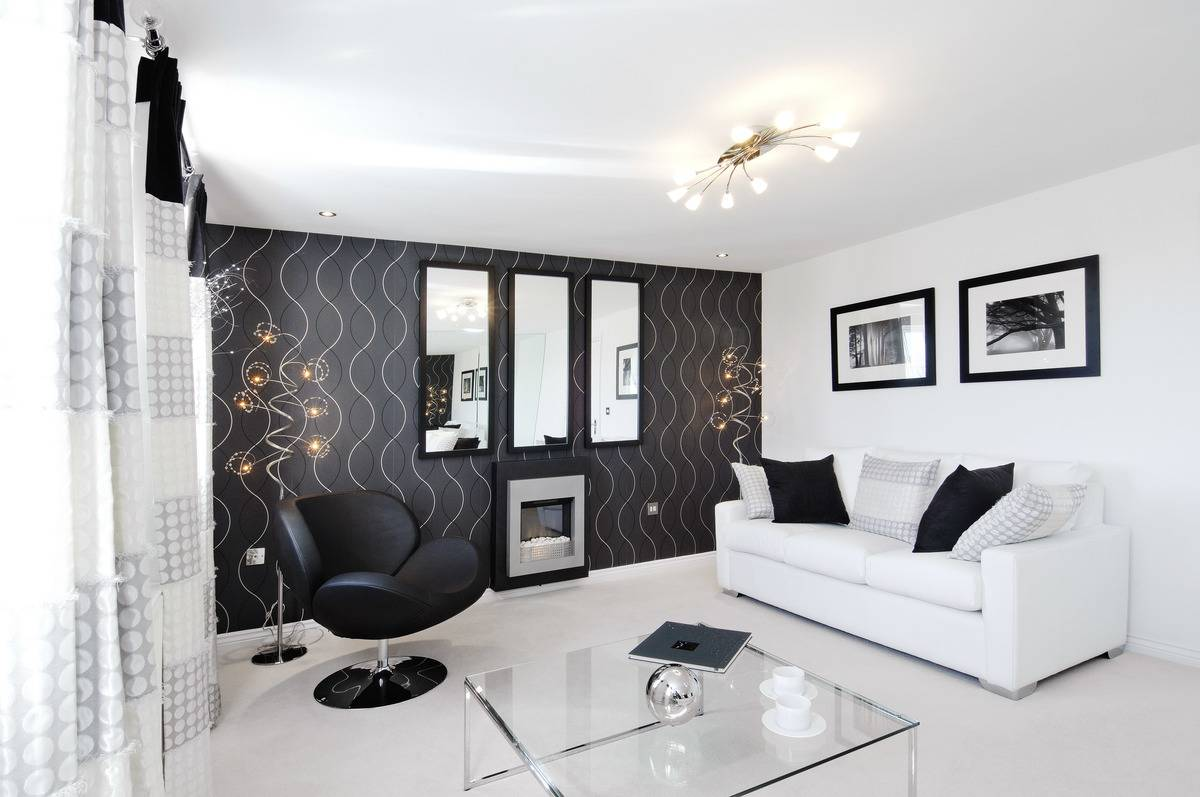 A luxury lounge features modern, black-and-white furniture and decor.