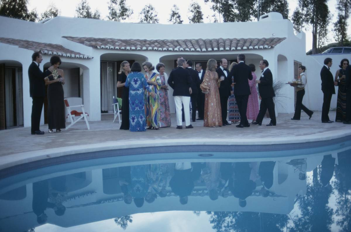 Rich people gather for a pool party in Portugal, 1973.