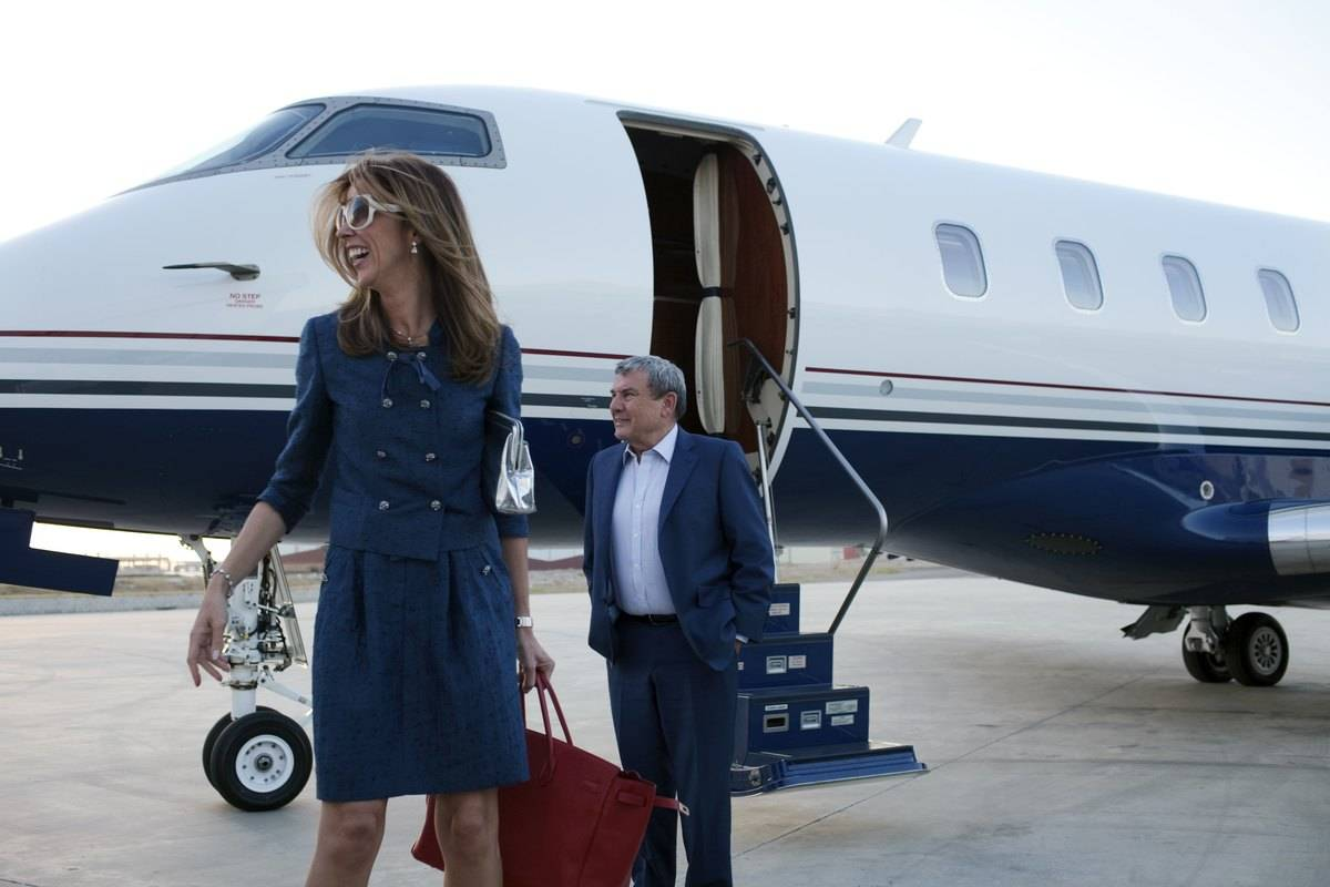 A hotel magnate walks out of her private jet.