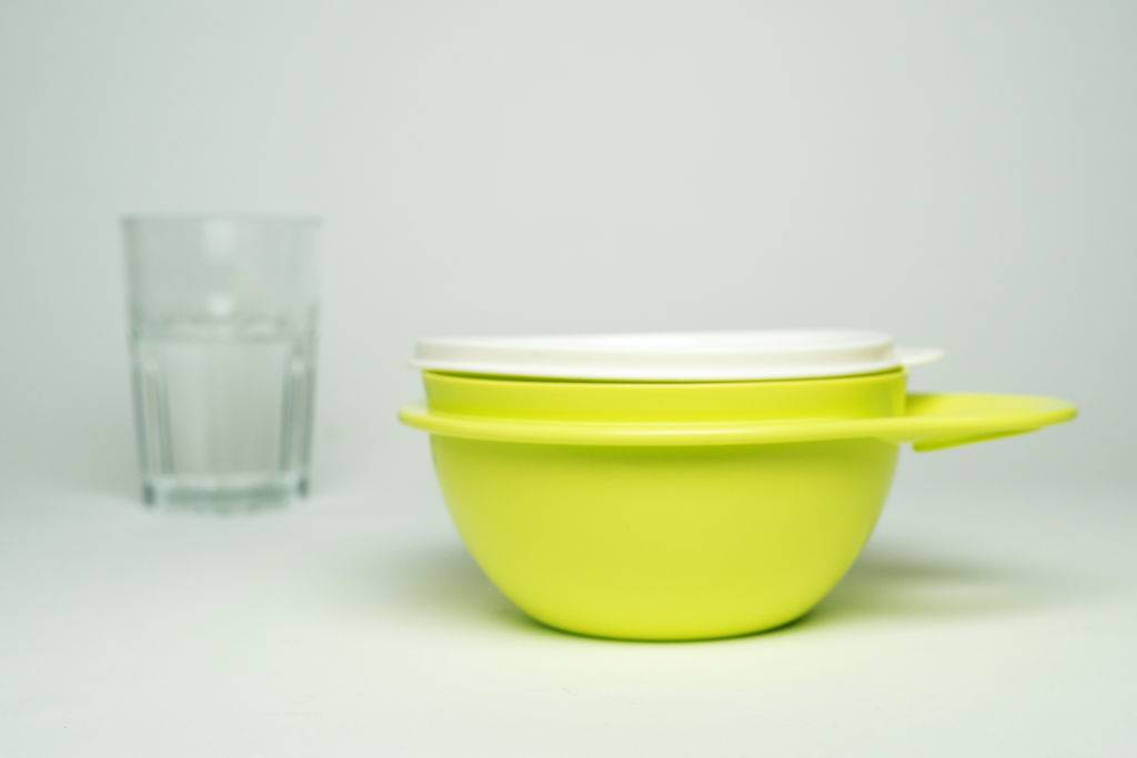 tupperware container with a glass