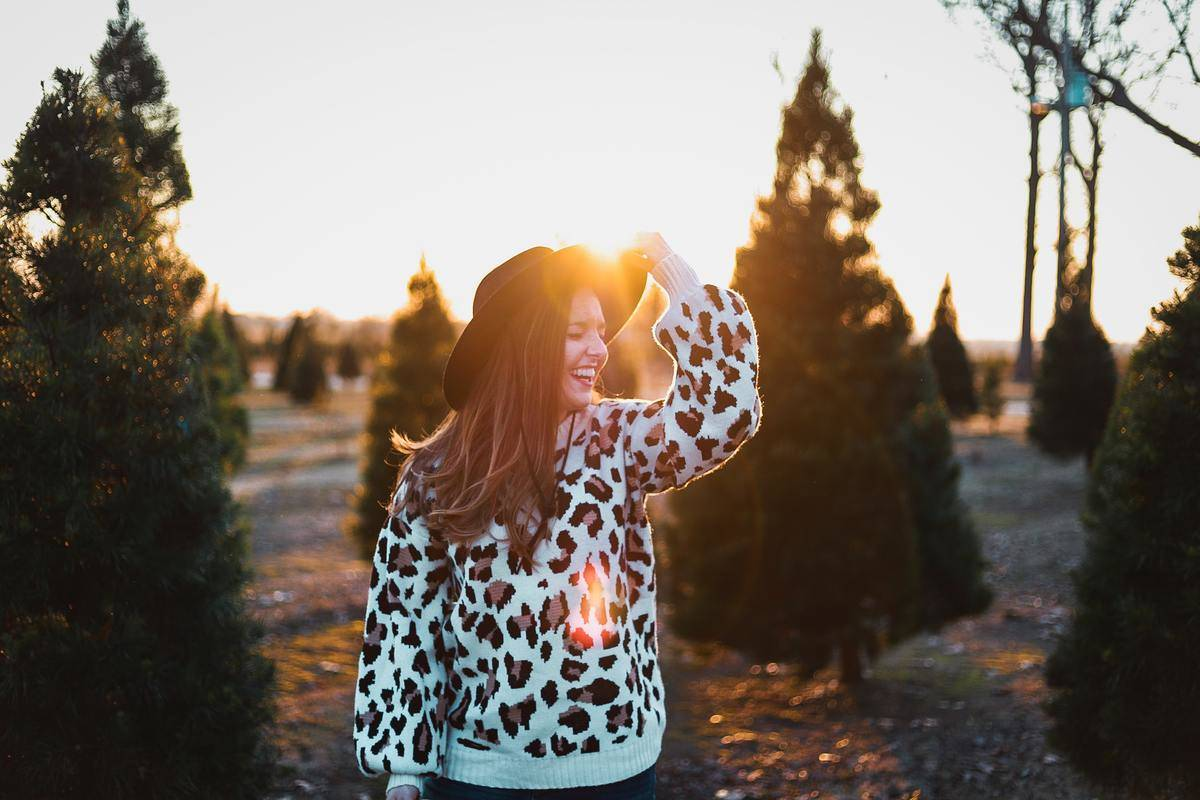 A woman laughs in front of an Arkansas sunset.