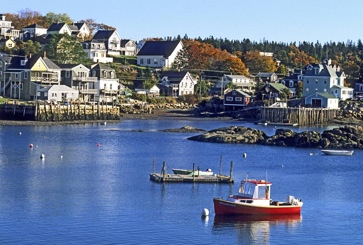 Boats float in the harbor of Stonington Harbor, Maine.