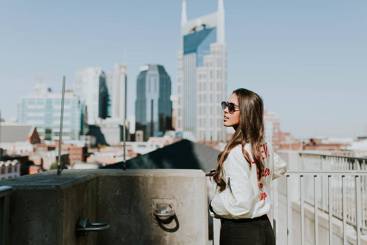A young lady looks out at the Nashville cityscape.