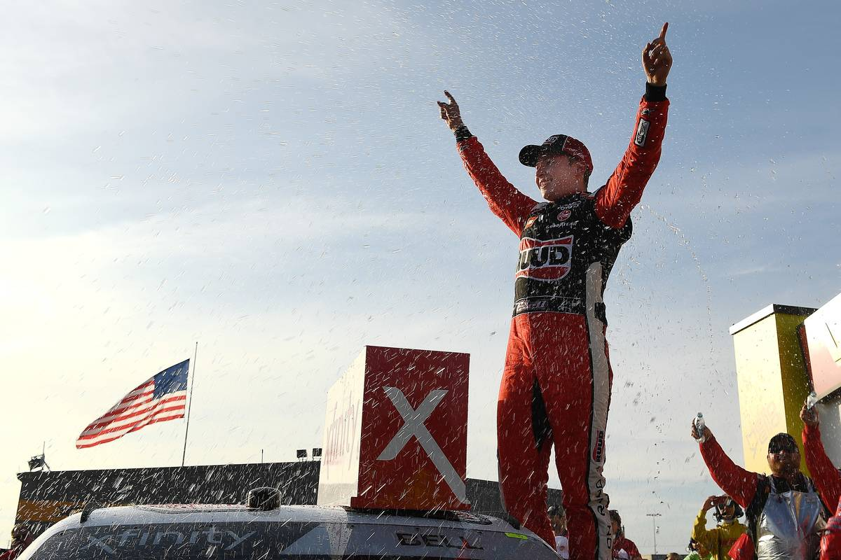 Christopher Bell celebrates in Victory Lane after winning the NASCAR Xfinity Series.