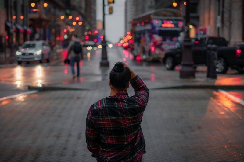 A woman crosses a street in Philadelphia.