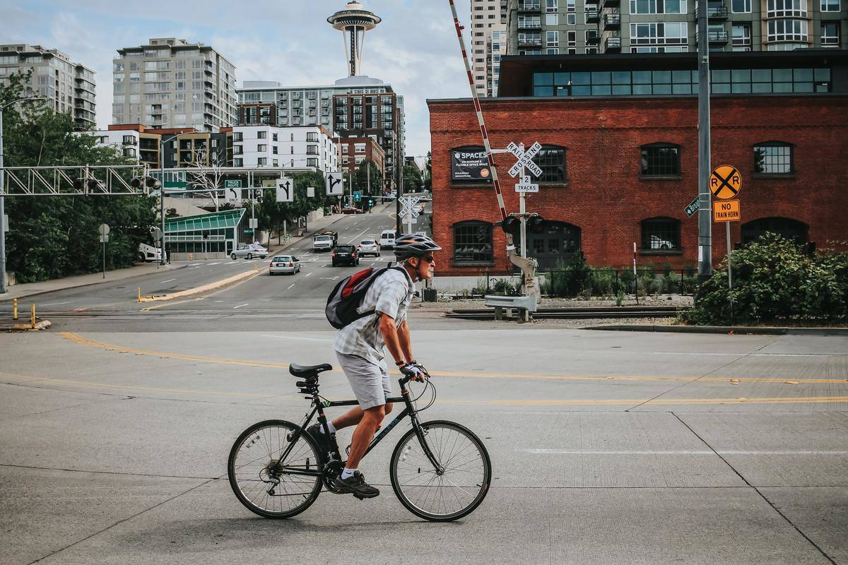 A man rides his bike in Seattle.