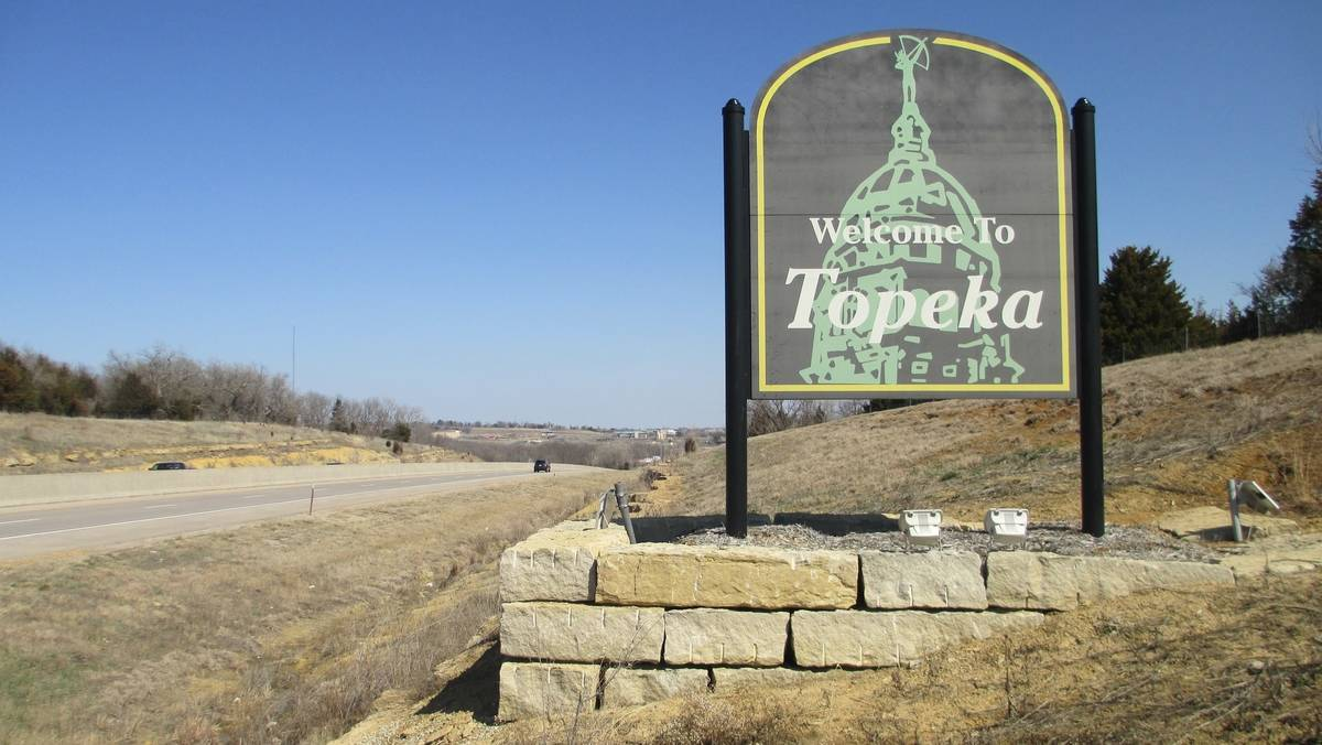 A sign welcomes people to Topeka, Kansas.