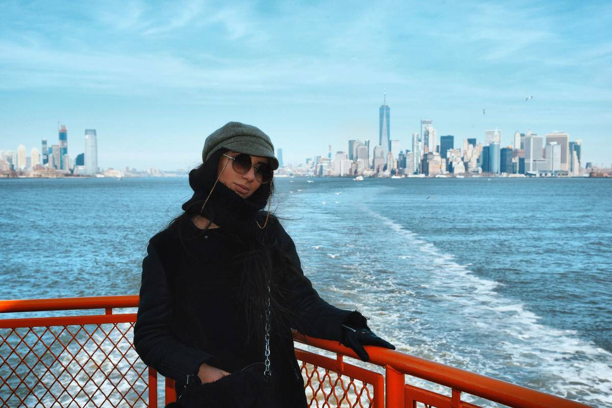 A woman rides a ferry from New York.