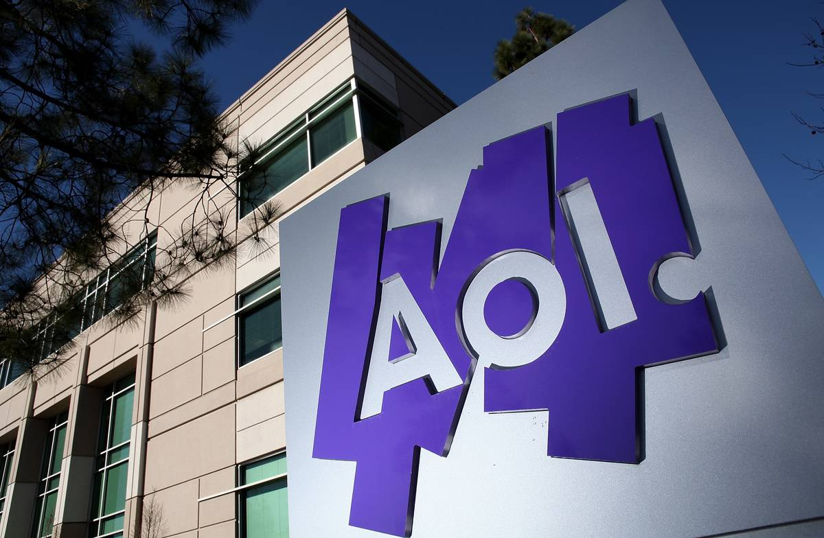 An AOL logo is posted in front of the company building.