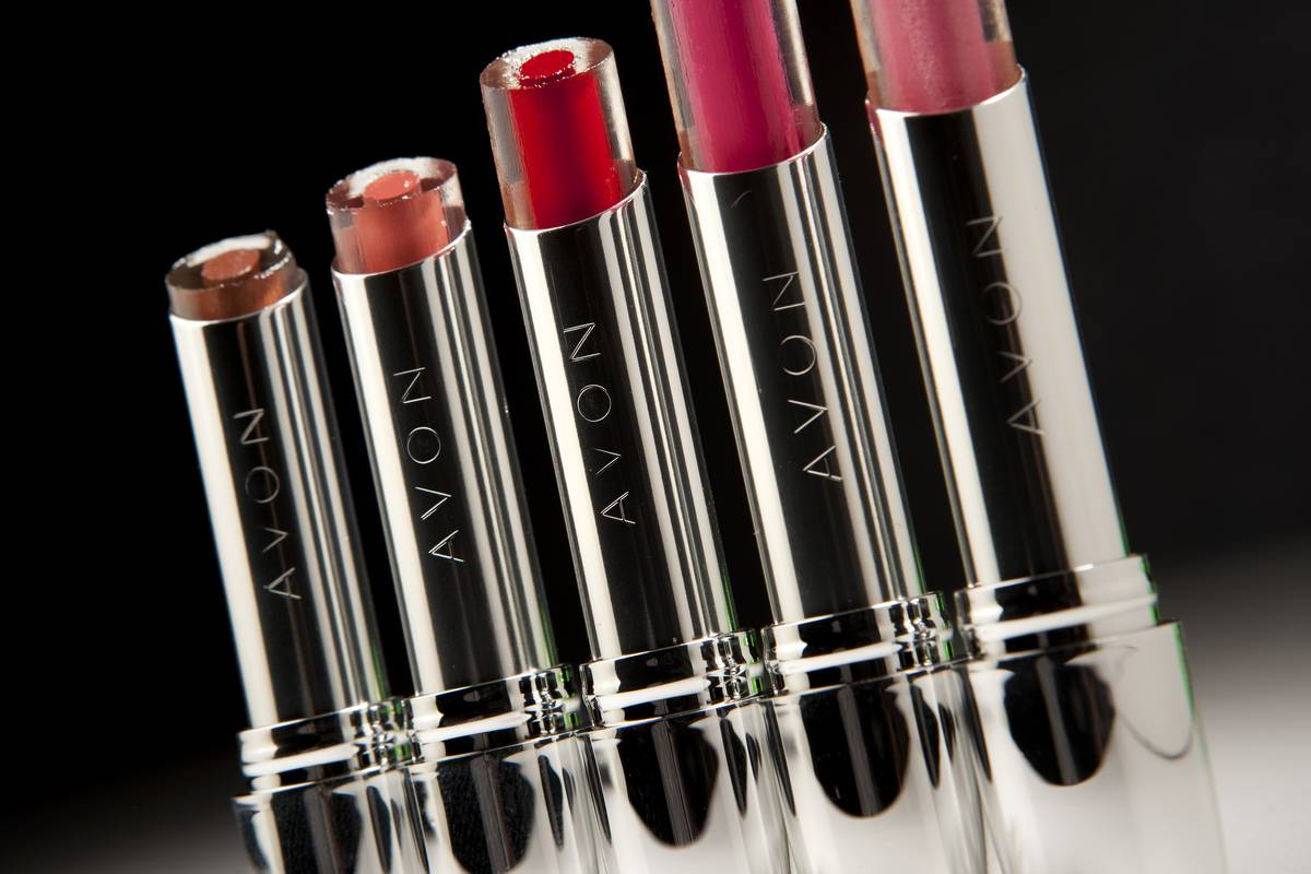 Several Avon lipsticks are on display.