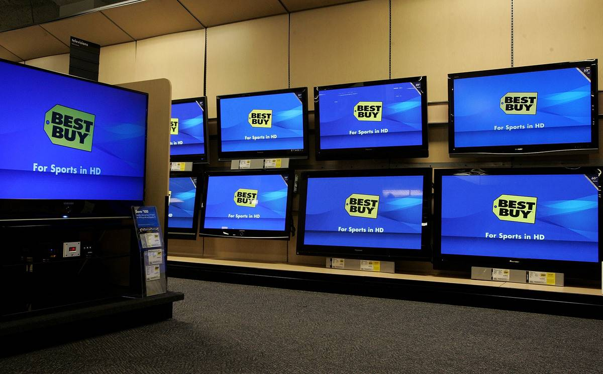 Flat panel televisions in Best Buy display the store logo.