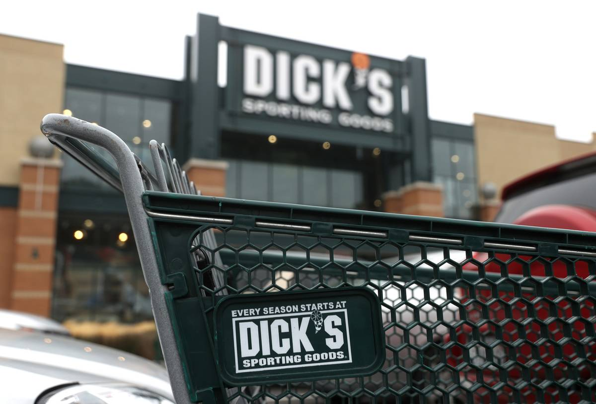 A shopping cart is in front of a Dick's Sporting Goods.