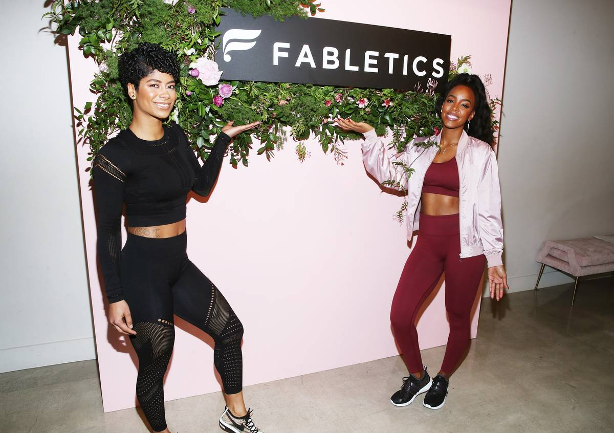 Health Coach and Personal Trainer Massy Arias and Kelly Rowland attend the opening of a Fabletics store.