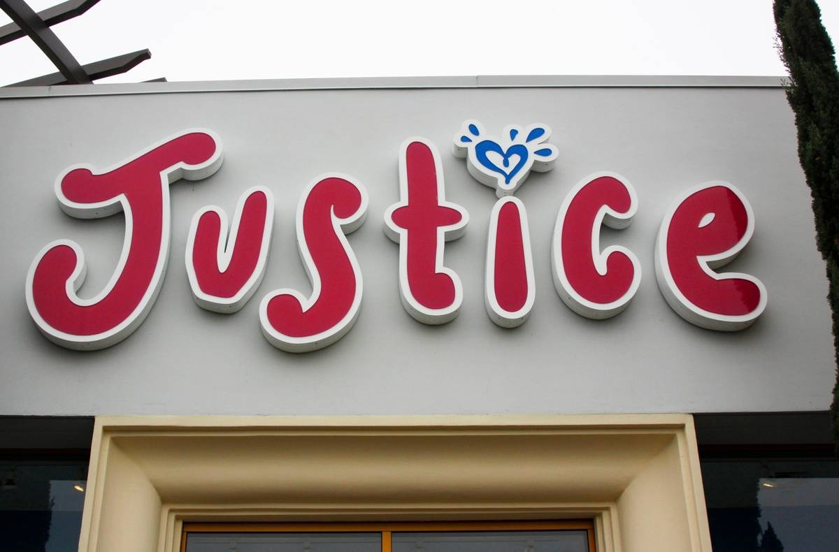 A close-up shows the logo of the store Justice.