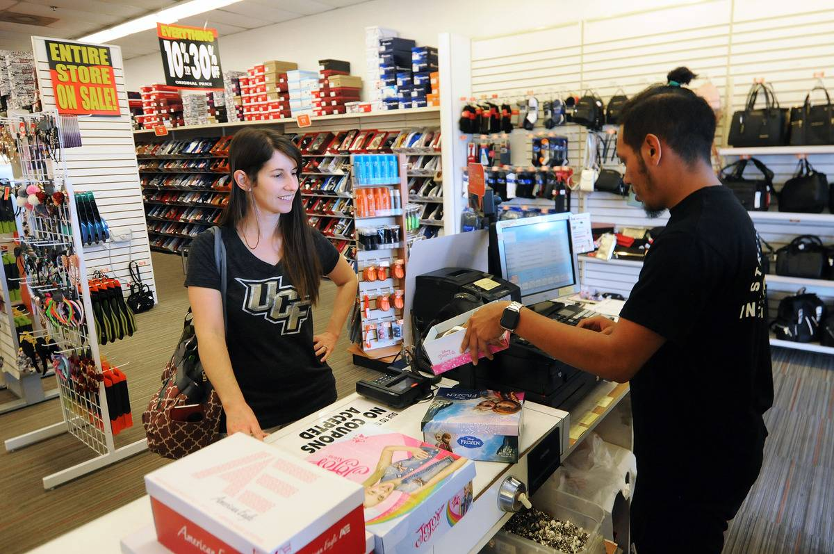 A customer buys shoes at a Payless ShoeSource that is going out of business.