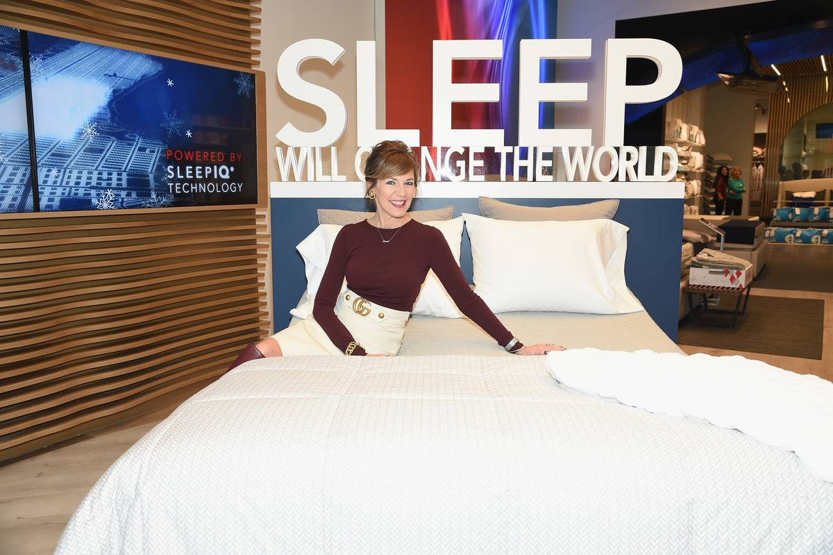 A woman promotes a mattress inside a Sleep Number store.