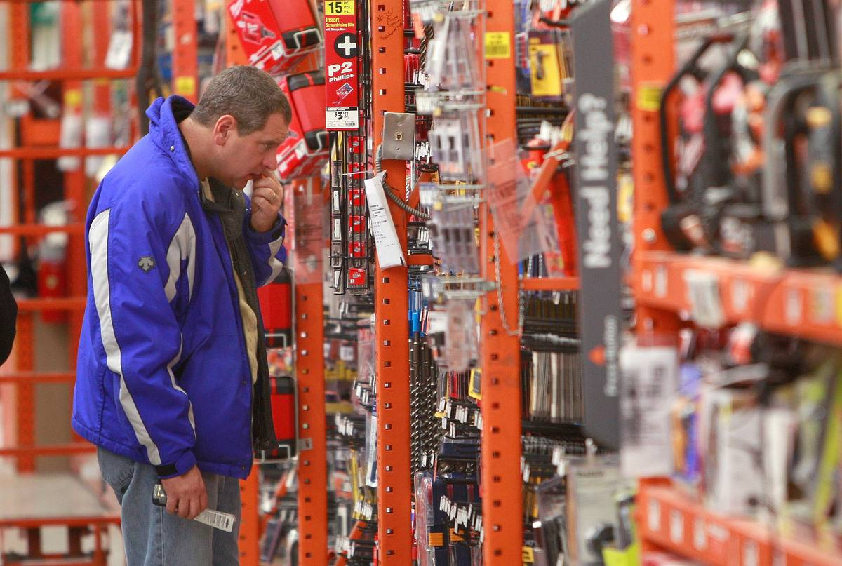 A man browses the tool section at Home Depot.