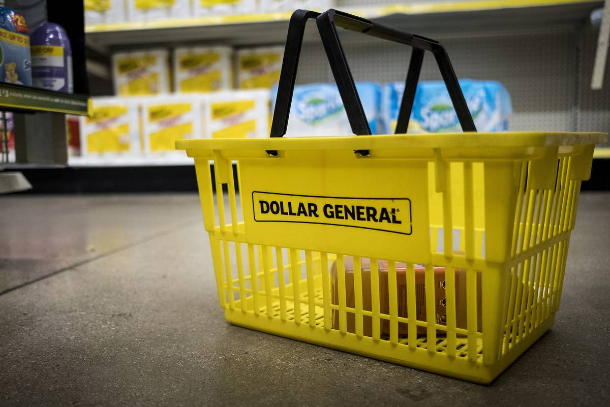 A yellow shopping basket for Dollar General sits on the ground.