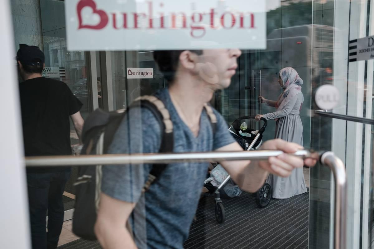 A man enters a Burlington store.