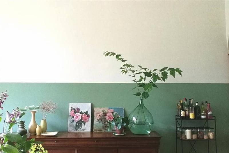 Half a wall is painted green, horizontally.