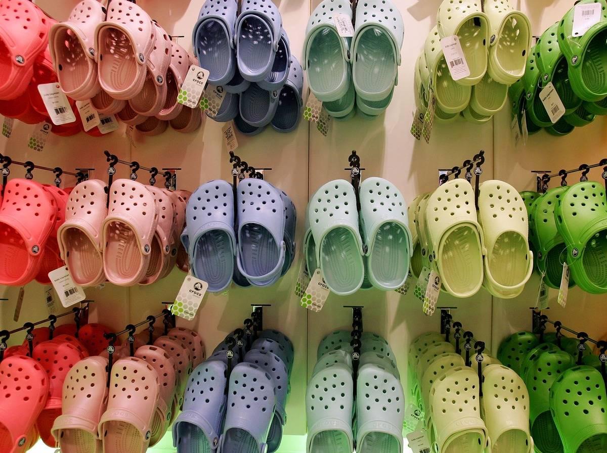Multi-colored Crocs hang in a Crocs store in London.