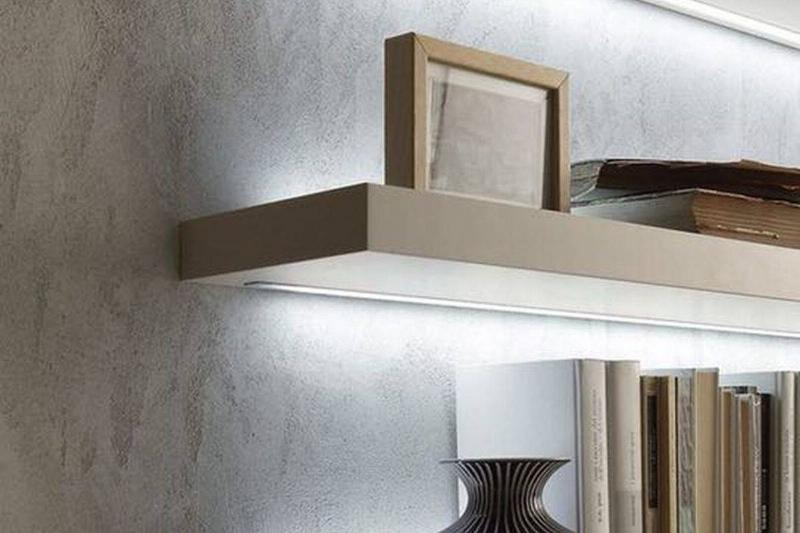 LED Lights are attached to the bottom of shelves to illuminate them.