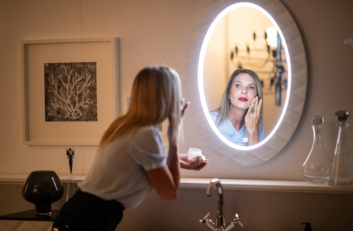 Princess Maja von Hohenzollern does her makeup with her bathroom mirror.