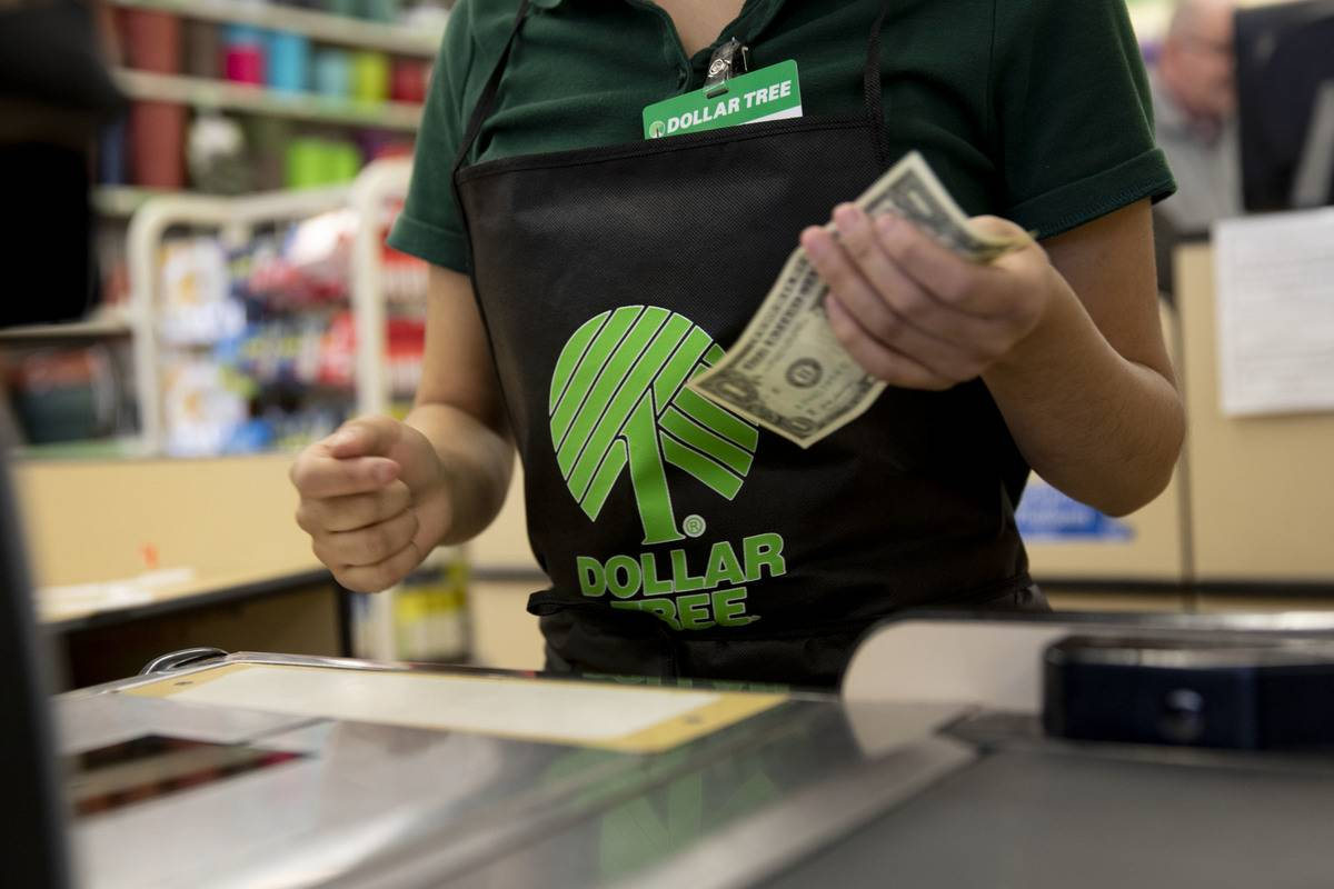 A cashier at the Dollar Tree accepts a $1 bill.
