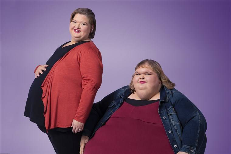 The 1,000 lb sisters pose together against a purple background.