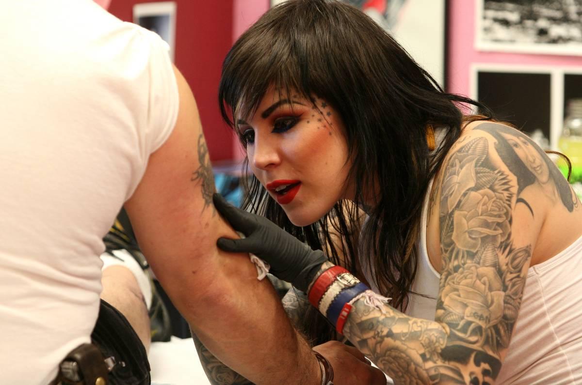 LA Ink's Kat Von D tattoos a customer at High Voltage Tattoo.