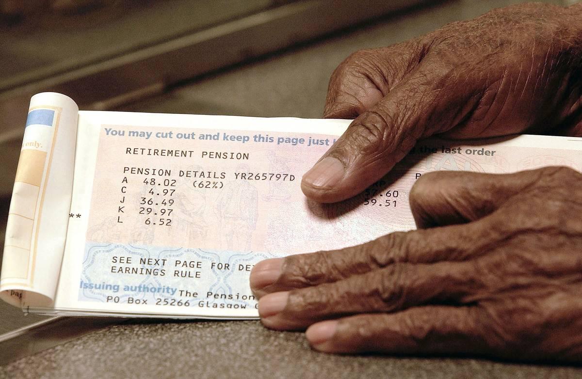 A man handles his retirement pension book.
