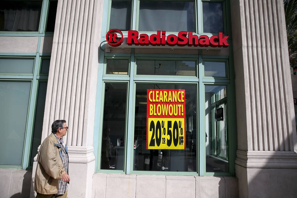 A clearance sign is on the front window of a RadioShack store.