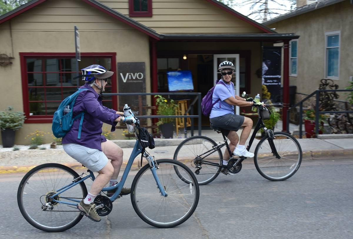 Two retired women ride bikes in Santa Fe, NM.