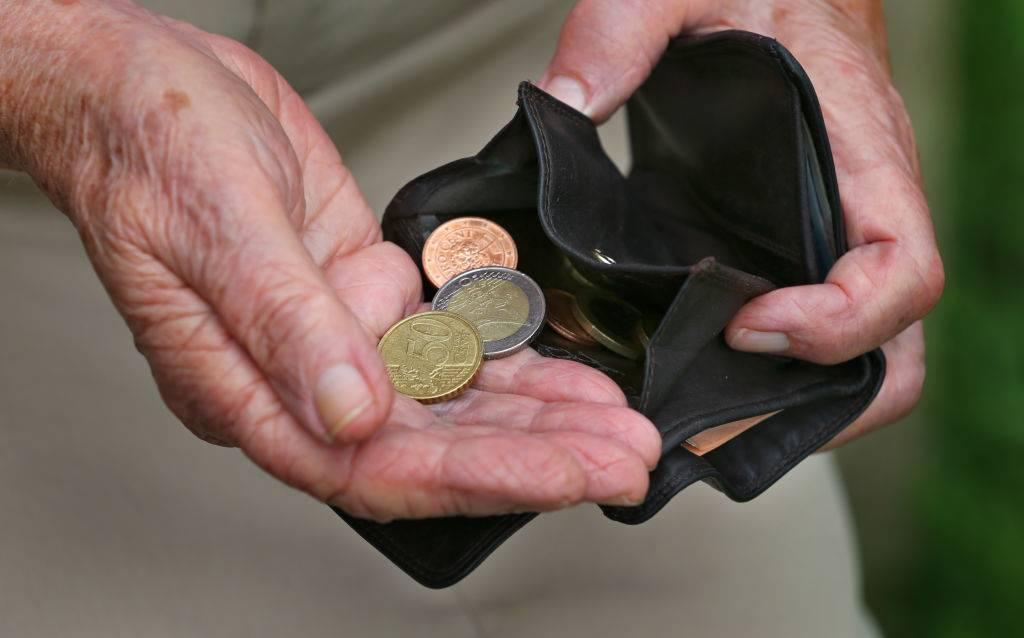 senior-holding-coins