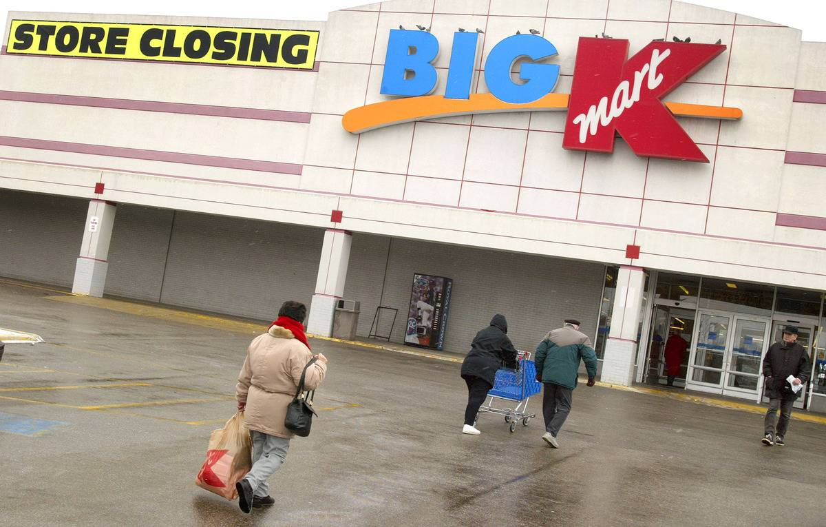 Shoppers walk into a Big Kmart that is closing soon.