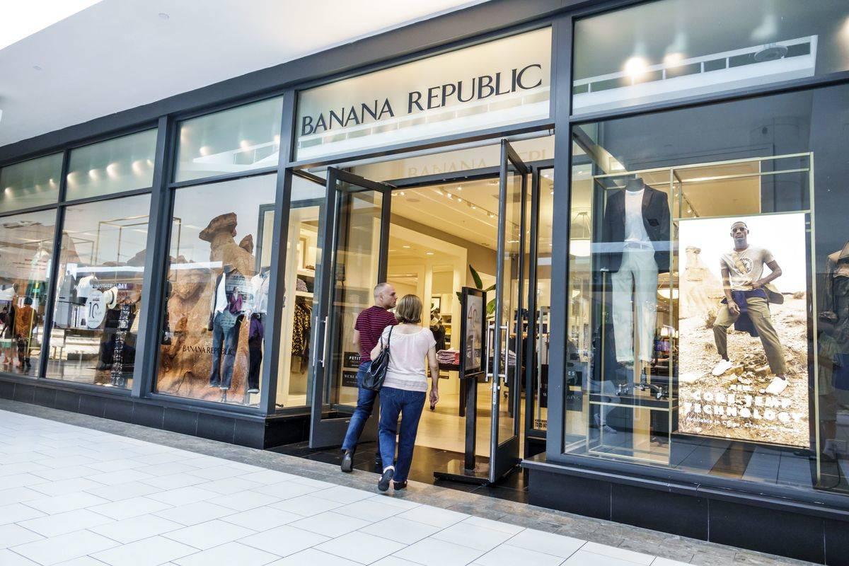 A couple walks into a Banana Republic store.