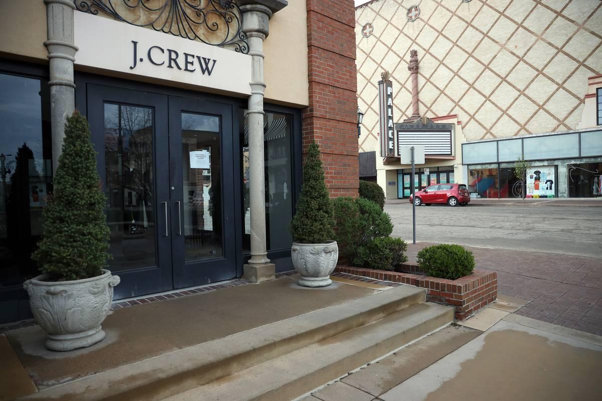 A closed J. Crew is seen on a street corner.