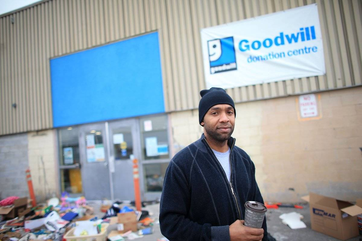A former employee walks in front of a shut down goodwill.