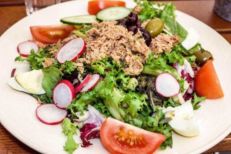 a salad with tuna, tomatoes, radishes, and cucumbers
