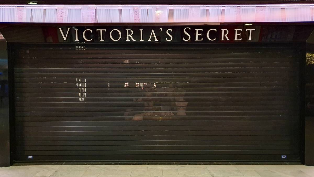 A Victoria's Secret store is closed down in a mall.