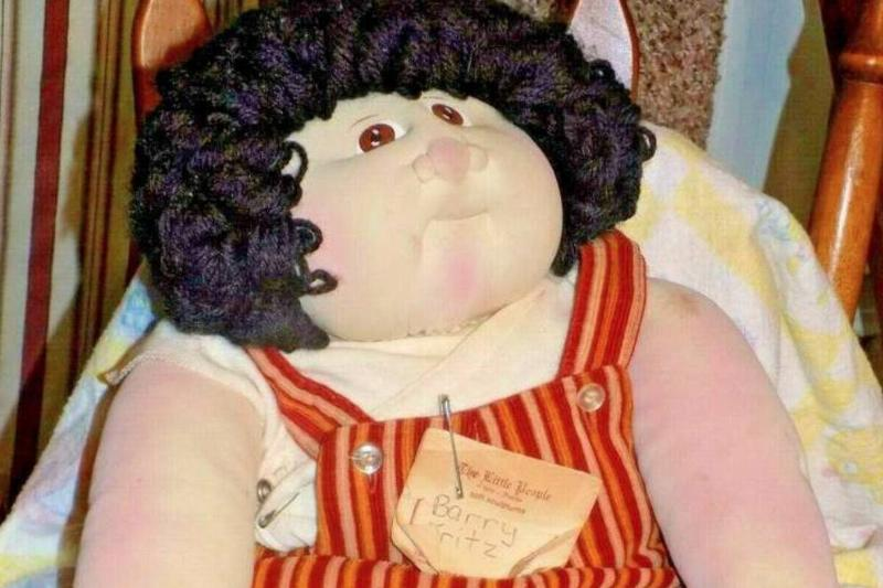 A Barry Fritz Little People doll from 1979 is propped up for an eBay listing.