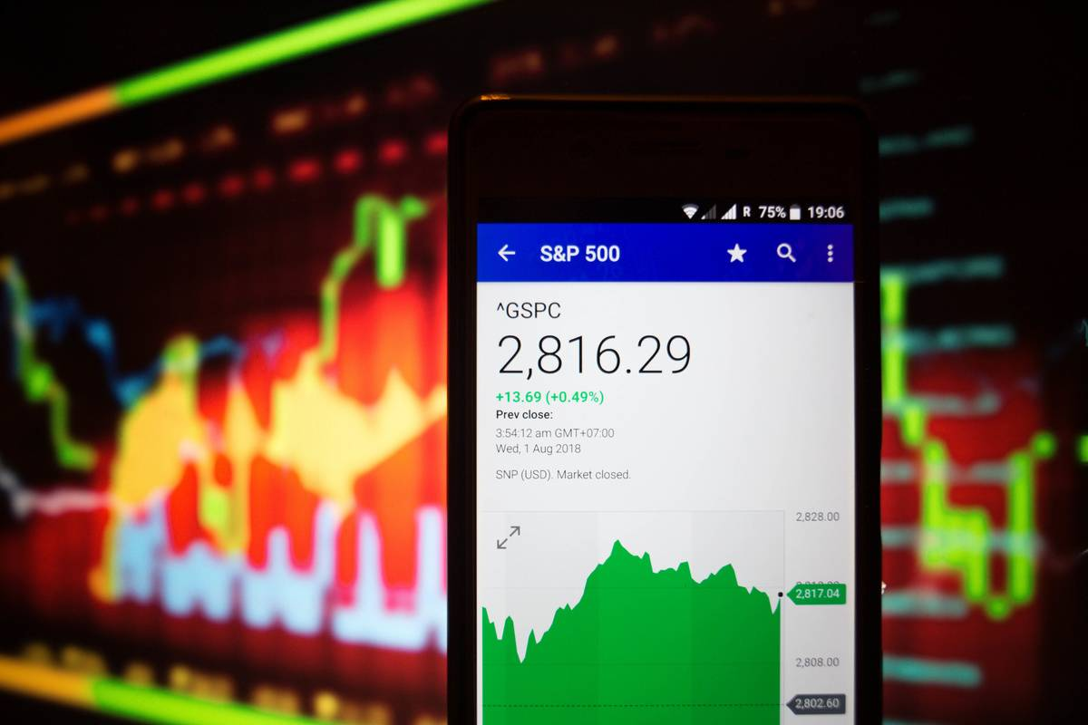 A smartphone displays the S&P 500 market value on the stock