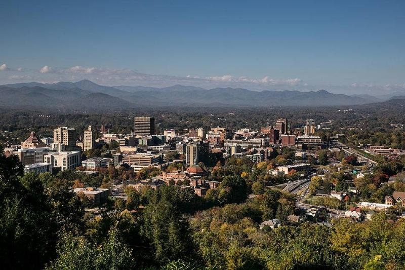The downtown skyline is viewed on a sunny autumn day in Asheville, North Carolina